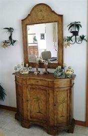 Curved front credenza with Palm Trees on each of 3 doors and inside shelf and one drawer. Matching curve top mirror. Animal print candlesticks. Giraffe and Elephant metal Pam tree sconces. Resin candle holders also in animal theme.