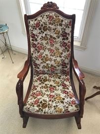 Check out the beautiful carvings on this nice rocking chair.