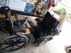 WHEEL CHAIR AND AN ELECTRIC  SCOOTER WITH EXTRA WHEELS