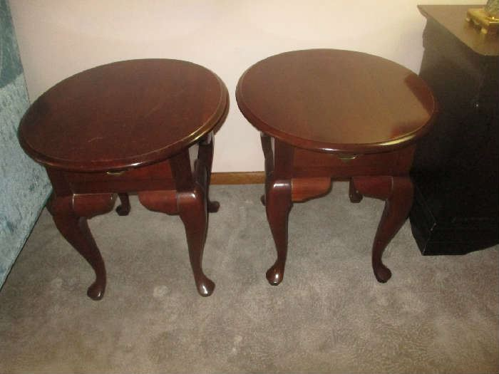 Pair of cherry oval end tables with drawer