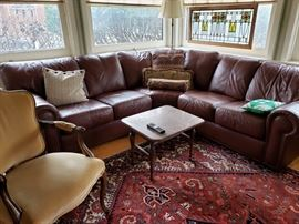 L-shaped leather sofa and Victorian French style chair