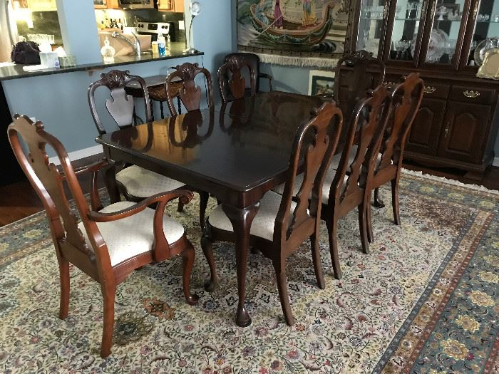 Stickley cherry dining room table with leaf, pads and 8 chairs