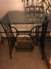 Converted sewing machine base with glass top table