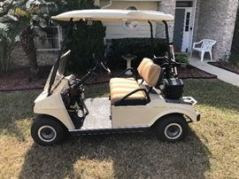 Club car golf cart. Owner spent over $1,600 updating this golf cart JUST last year.