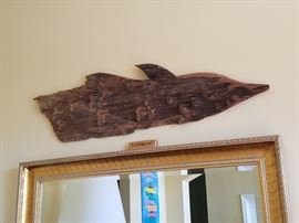 Dolphin carved board