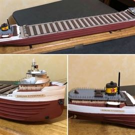 Edmund Fitzgerald replica model, approximately 4' long. Comes with enclosed case. Excellent condition.