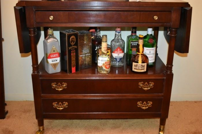 A closer look at the Collectible Bottles and the Gorgeous Tea Cart with Drop Leaf Ends and 2 Drawers