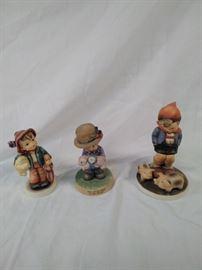 two Hummel and one Debbie bell Jarrett figurine , lucky boy, Farm Boy https://ctbids.com/#!/description/share/121965