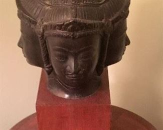 Mounted four head bronze Buddha