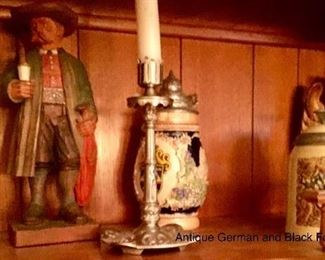 Black Forest carved figure pictured with beer steins