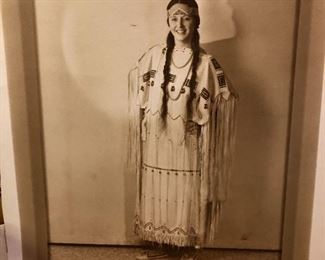 Signed hand colored portrait of ancestor in native  dress.