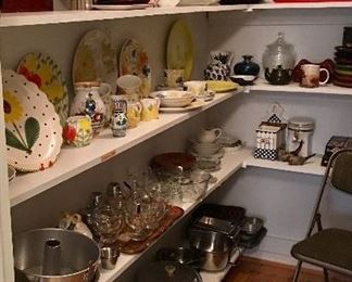 Butlers pantry full of serving pieces, china from around the world and collectible art glass and pottery, vintage cookware