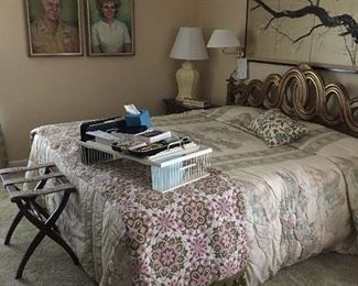 Large view of the master bedroom with a vintage bedspread shown on the foot of king bed and nice wicker bed tray table.