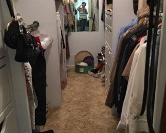 Closet with furs, cocktail purses, ties, shoes and other items.