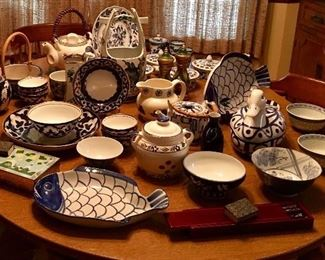 Table full of blue and white china serving pieces
