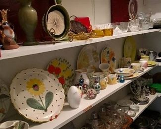 Butlers pantry full of serving pieces, china from around the world and collectible art glass and pottery