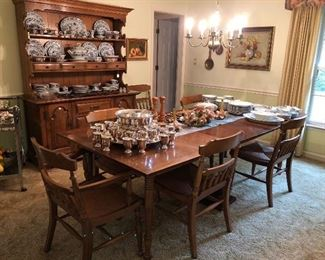 Dinning room table and hutch with six chairs.  Made of solid hard rock maple.   There is one arm chair.  Also available four matching chairs from another sale.   Table will seat 10.