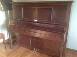 Totally restored player piano.....pump feet style.  Several rolls of music too