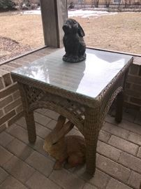 Wicker side table w/glass top.  Rabbits