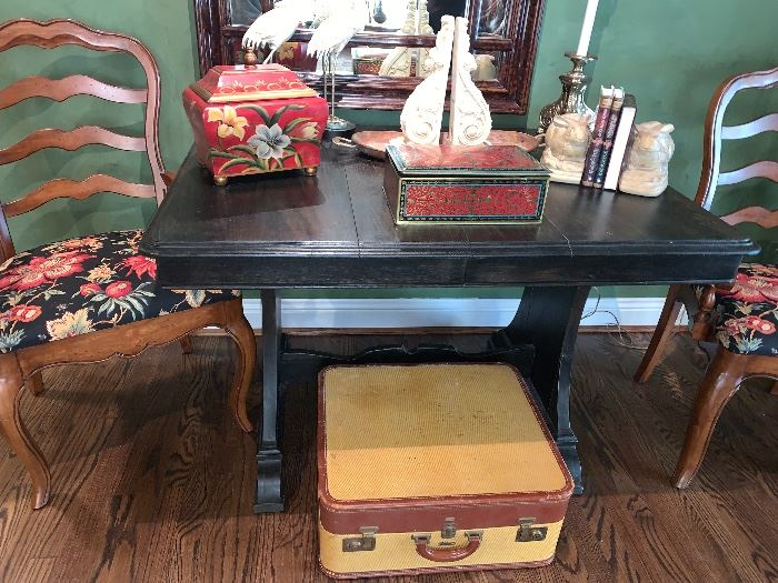 Vintage luggage- put some legs on it  and it makes a great side or coffee table