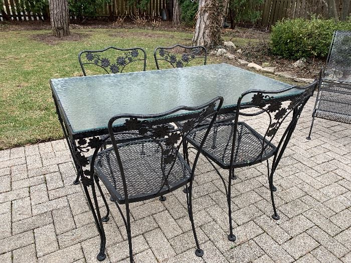 Outstanding vintage Wrought Iron and glass aptio set w/ 4 chairs