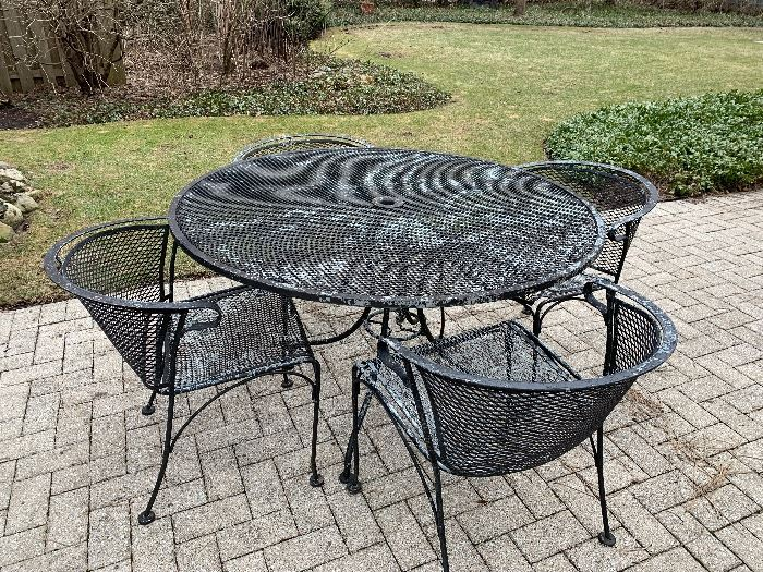 Wrought Iron round patio set with 4 barrel chairs