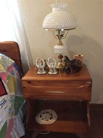 nightstand and milk glass lamp