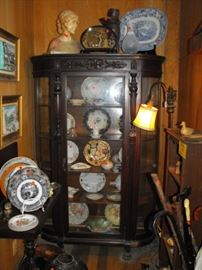 beautiful antique cabinet with curved side glass and lion feet