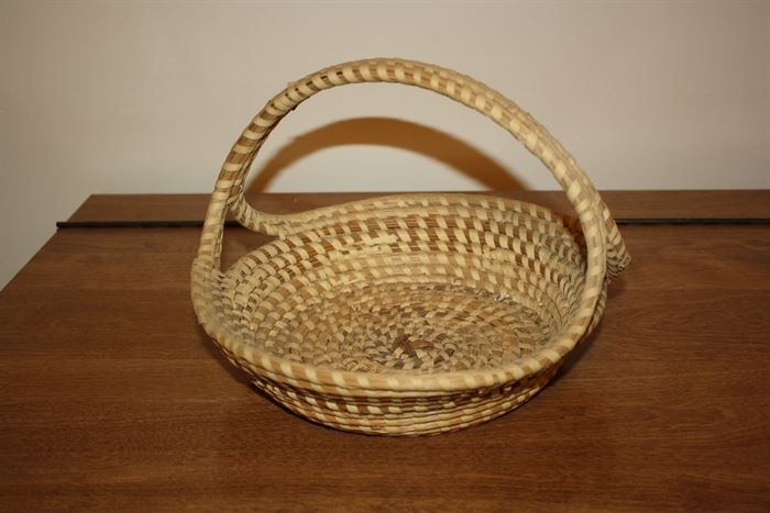 I have never seen one of these in Henry County before.  It is a sawgrass basket  hand made in the Charleston SC area  probably by the Gullah.  You can rarely find them outside of the Charleston area.