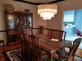 Glass-inlay dining room table with 8 chairs, 2 table leafs, table pads and lighted china cabinet