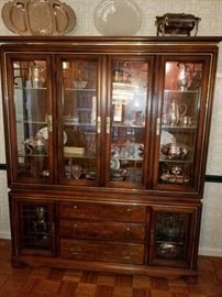 Lighted, glass front china cabinet with drawers