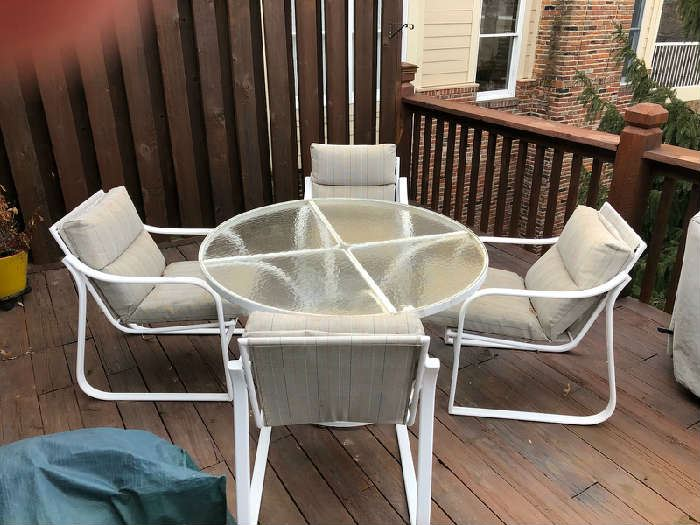 Glass-top patio set with 4 chairs and chair pads