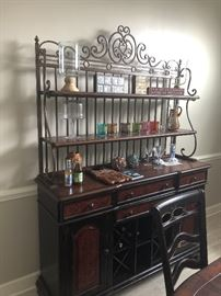 Unique and stylish piece.,used as a bar but perfect for any room in the house. Iron and wood with lots of storage. Beautiful faux finish detail.