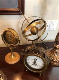 Beautiful collection of brass clock, compass, and sphere