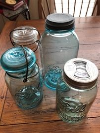 Very old and unique mason jars. Some have glass inserts in top