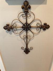 Scrolled iron cross on the hallway