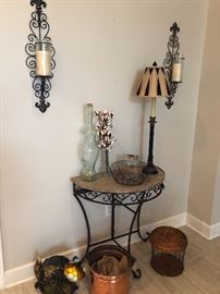 A collection of unusual and unique- cat fan. Small iron and marble table. Copper bucket with original tags. Glass bottle with cork. Pair of iron wall sconces and more