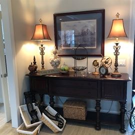 Another view of the buffet and another set of large iron wall sconces