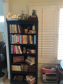 One of three bookshelves for sale . This one holds a great selection of cookbooks