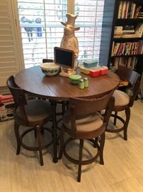 Very nice tall table with four matching bar stools. Great for the kitchen nook or a smaller space.  Would be a fun game table or a great for the first home