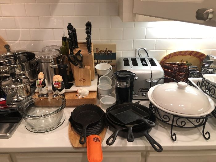 Cast iron pans in great condtion with a very nice knife set and a super stainless toaster
