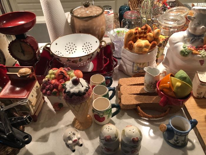 New scales. Colorful enamel colander. Decorative salt and pepper shakers. A chef Piggy cookie jar. This sale is better than a trip to any specialty kitchen store