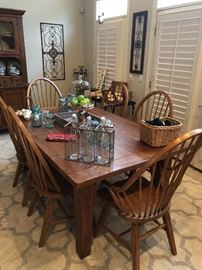 A dining table with great chairs. Beautiful wood, the farm house look for today's home.