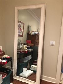 Very tall mirror. Great for your home or store