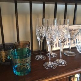 colorful rock glasses next to champagne flutes