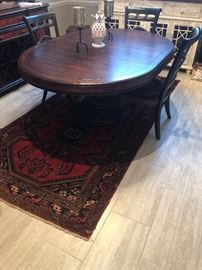 a gorgeous oval table with one leaf insert. Super nice. Extremely well made and sturdy dining table with impressive center base. Beautiful solid wood table with attractive matching chairs that have a light faux finish hand painted on the edges