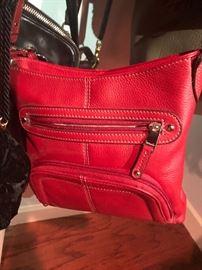 a beautiful red Coach bag