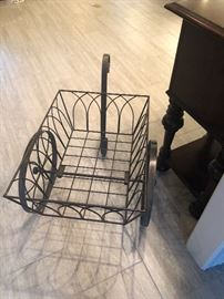 this is an interesting piece. indoor or out. It has the look. Iron cart