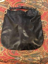 One of many designer bags-including BCBG, Tahari, Badgley Mischka and many more