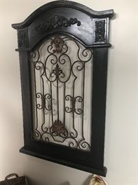 another wood and iron wall hanging.